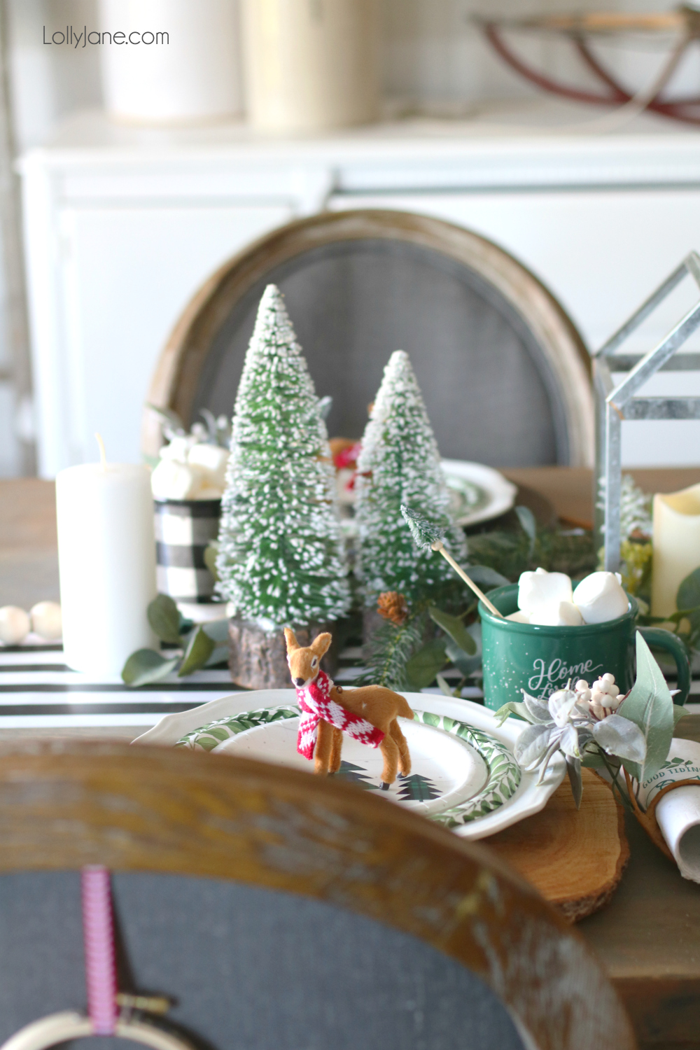 Bottle brush trees are ALL the rage right now and are so versatile when it comes to decorating for the holidays! See how we used them for the cutest ever Christmas tablescape! #christmas #christmastablescape #christmascenterpiece #centerpiece #wintertablescape #diy
