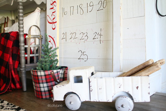 Such a fun Christmas countdown idea using an old window pane and dry erase markers! Love the boxwood wreath and old truck too! #easydecorations #christmasdecor #christmascountdown #countdowntochristmas