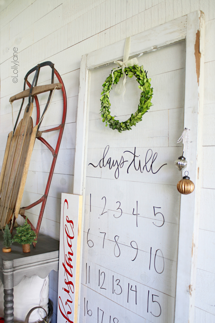 Look how easy it is to make a Christmas countdown! We used an old window to create a dry erase Christmas countdown using dry erase markers. Hang a boxwood wreath for instant easy Christmas decor! #diy #diyChristmas #christmasdecor #christmascountdown #dryerase