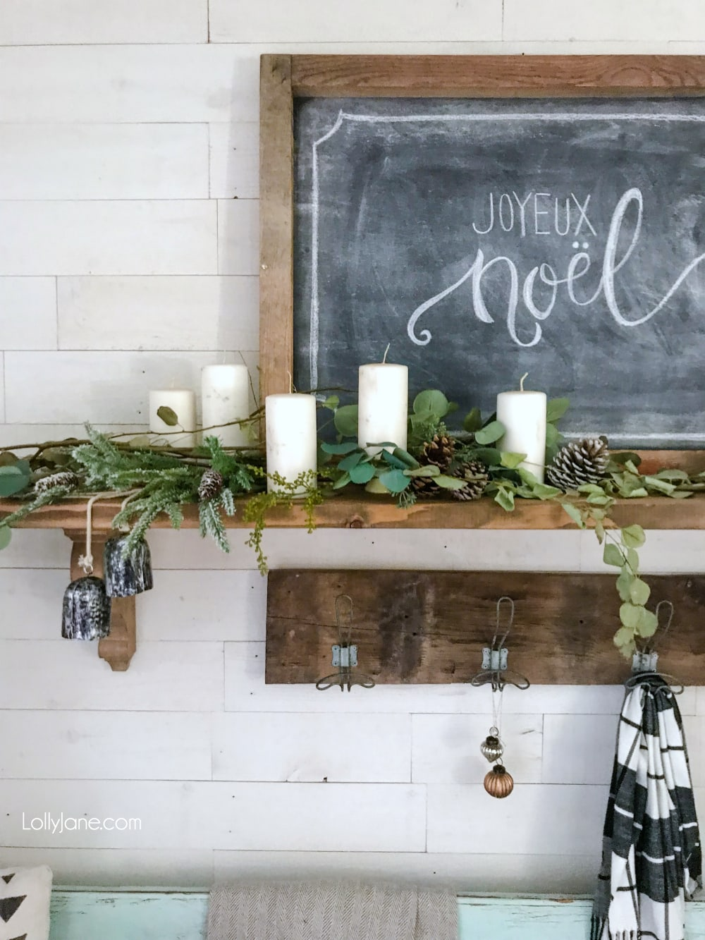 Grab some branches (greenery) from your yard, add a pinecone or two, some $1 store candles and a chalkboard with a festive phrase and BAM. Instant Christmas/winter mantel! EASY PEASY! #diy #christmasdecorations #winterdecor