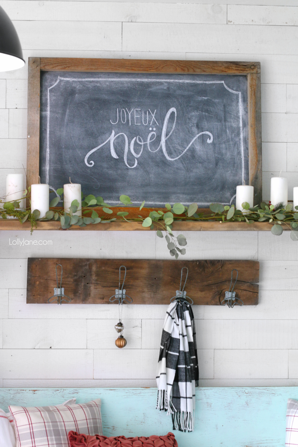 Simple wintery Christmas mantel with chalk art... feel festive without all the frills! Click through to see how this was put together! #diy #christmasdecorations #winterdecor