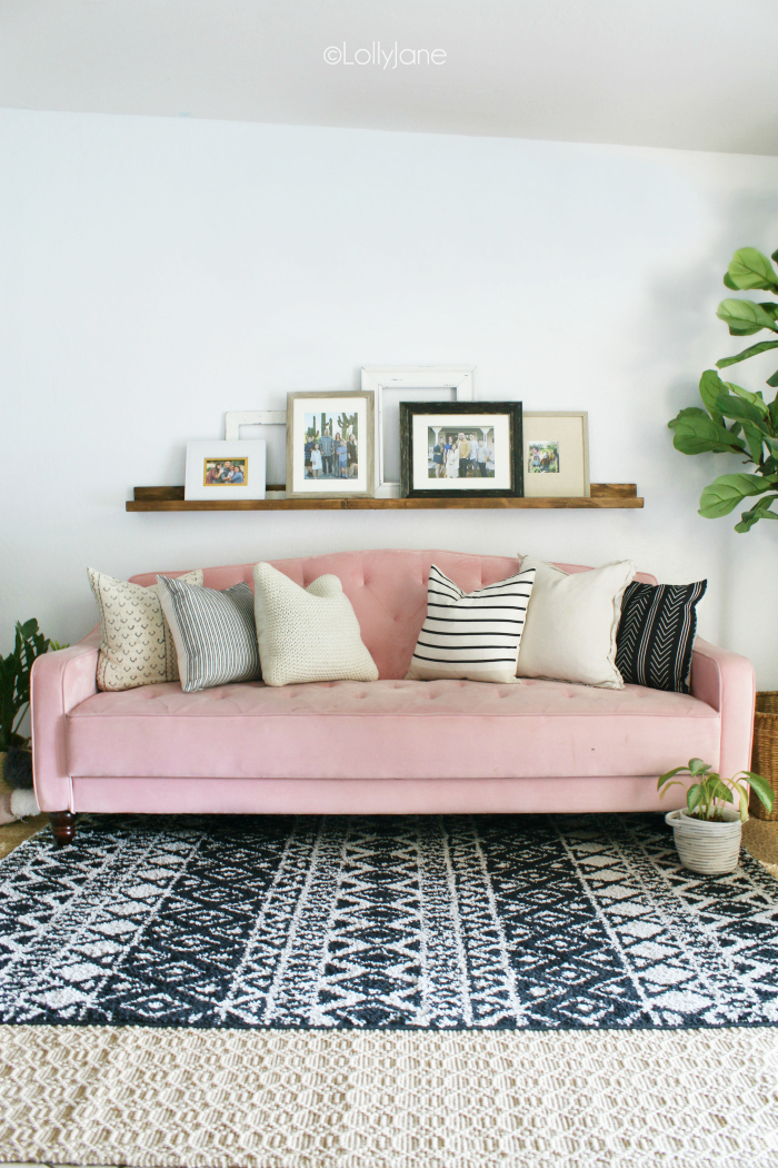 Decorating a boho chic living room. Love the layered rugs and pink velvet couch! #boho #bohostyle #boholiving #boholivingroomdecor