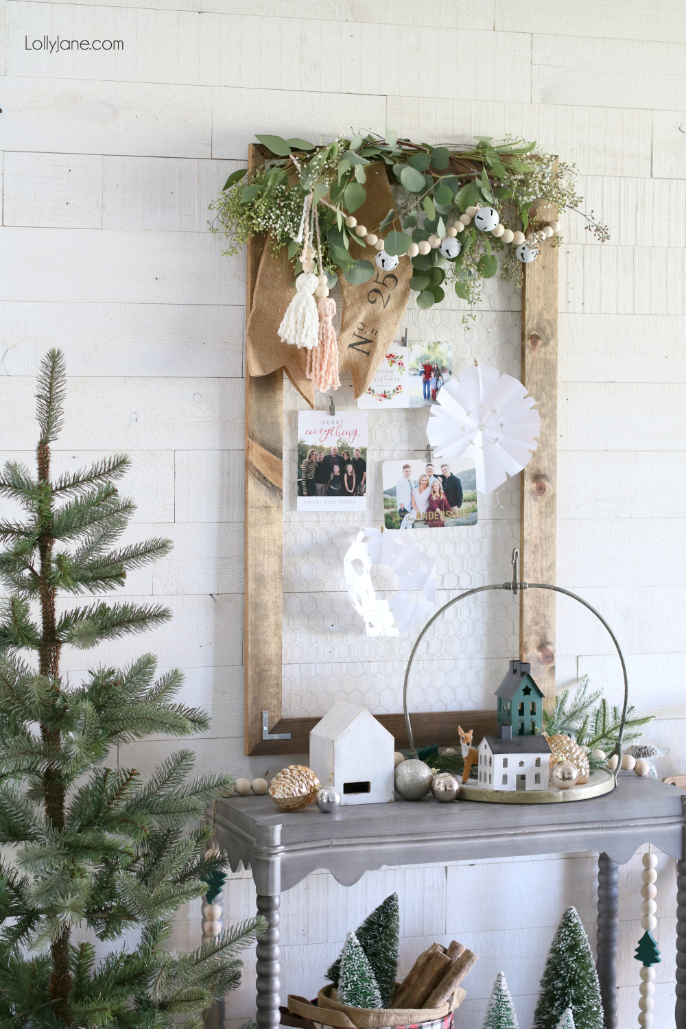 Easiest DIY Christmas Card Holder, top with leaves and this DIY garland + tassels to create the cutest display ever! #diy #garland #christmasdecor #wintervignette #diytassels