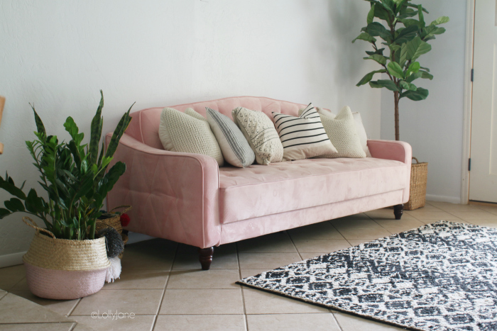 Remodeling a mid century modern living room starts with a fun pink tufted velvet couch and black and white accent pieces! #midcenturydecor #howtodecoratemidcentury #midcenturystyle