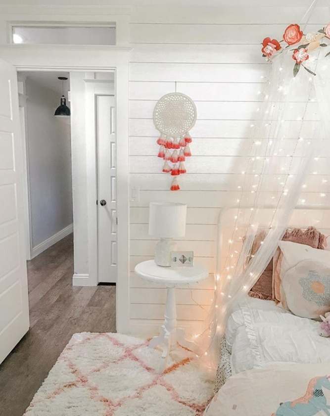 Add twinkle lights to a canopy for a soft hue to a little girls bedroom! #twinklelights #fairylights #girlsroom