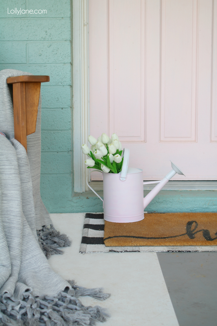 CUTE!! Spruce up a watering can with a bit of paint and these EASY tips! Add some fresh or faux florals for INSTANT spring ambiance! #homedecor #topspringideas #freshspringideas #springhomedecor