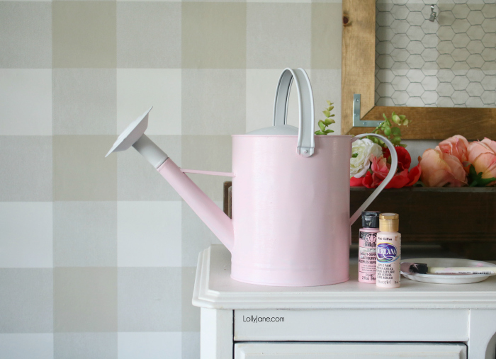SUPER CUTE and easy peasy watering can makeover. Click to see how to add instant SPRING vibes to your decor with just a few steps and for a few dollars! #homedecor #topspringideas #freshspringideas #springhomedecor