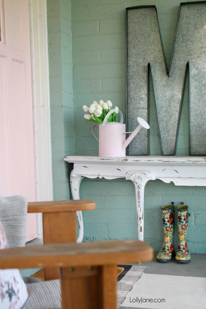 EASIEST MAKEOVER! Spruce up and old or ugly watering can with a little paint... get the full DIY, so simple and perfect for SPRING! Plus, check out these 26 new spring diy project ideas! From easy to make front porch mats to indoor spring decor, we've got you covered with lots of spring decor ideas! #homedecor #topspringideas #freshspringideas #springhomedecor