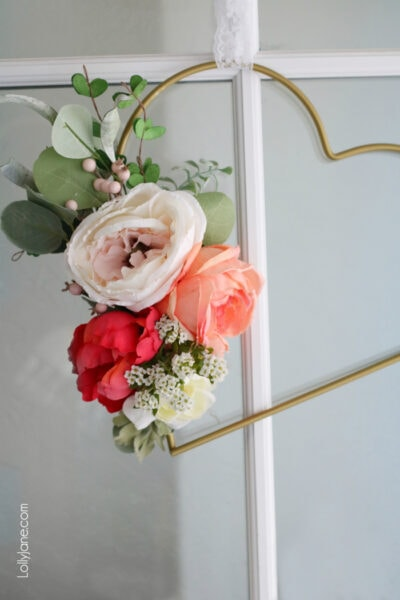 Easy DIY Metal Floral Heart Wreath. Spruce up a baby shower, nursery, girls room or decorate for Valentine's Day with! So pretty! #diy #heartwreath #diywreath