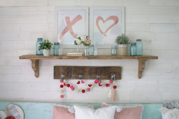 Valentines Day Decor | What a fun Valentine's Day entryway decor! Download these printables, frame them then place above a mantel or shelf for easy and affordable Valentines Day decor! #vintagevalentinesday #valentinesdaydecor #vdaydecor #vdaymantel #valentinesdaymantel #bluemasonjarcollection #pinkvaletinesdaydecor