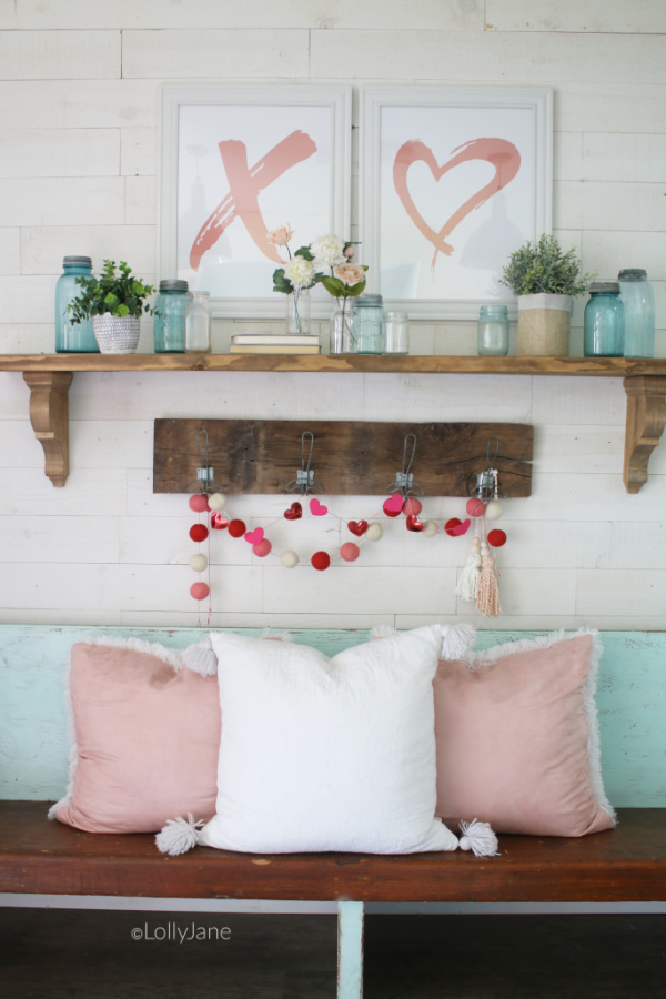 Easy to put together Valentines Day mantel | Such a fun pink and aqua VDay mantel idea! Don't forget to decorate your entryway for Valentines Day! #vintagevalentinesday #valentinesdaydecor #vdaydecor #vdaymantel #valentinesdaymantel #bluemasonjarcollection #pinkvaletinesdaydecor
