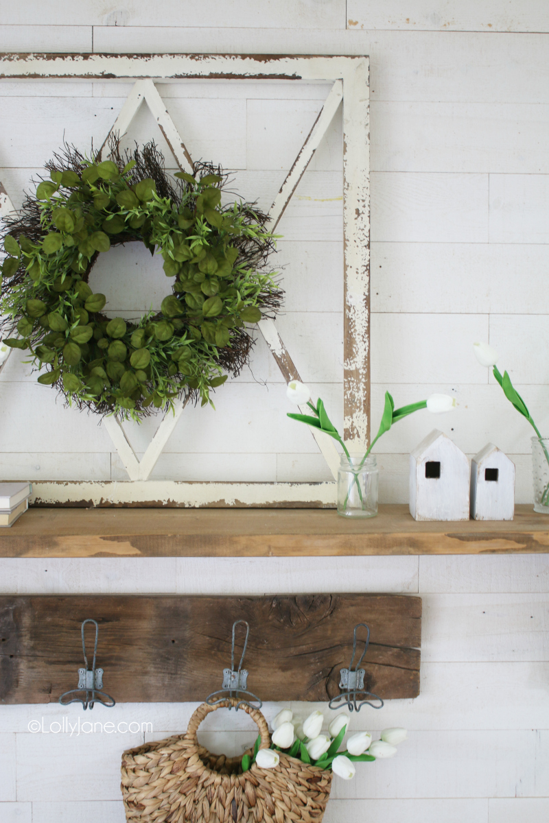 Love this fresh spring mantel decor with lots of natural pieces. Decorating with tulips is an easy way to welcome spring into your home! #tulips #springdecor #springdecorations #tulipdecor