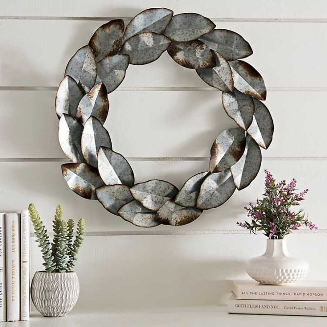 Love this galvanized wreath, the cutest farmhouse style decor! Add this metal wreath to your door or family room or kitchen for pretty farmhouse charm! #farmhouse #farmhousestyle #metalwreath #galvanizedwreath