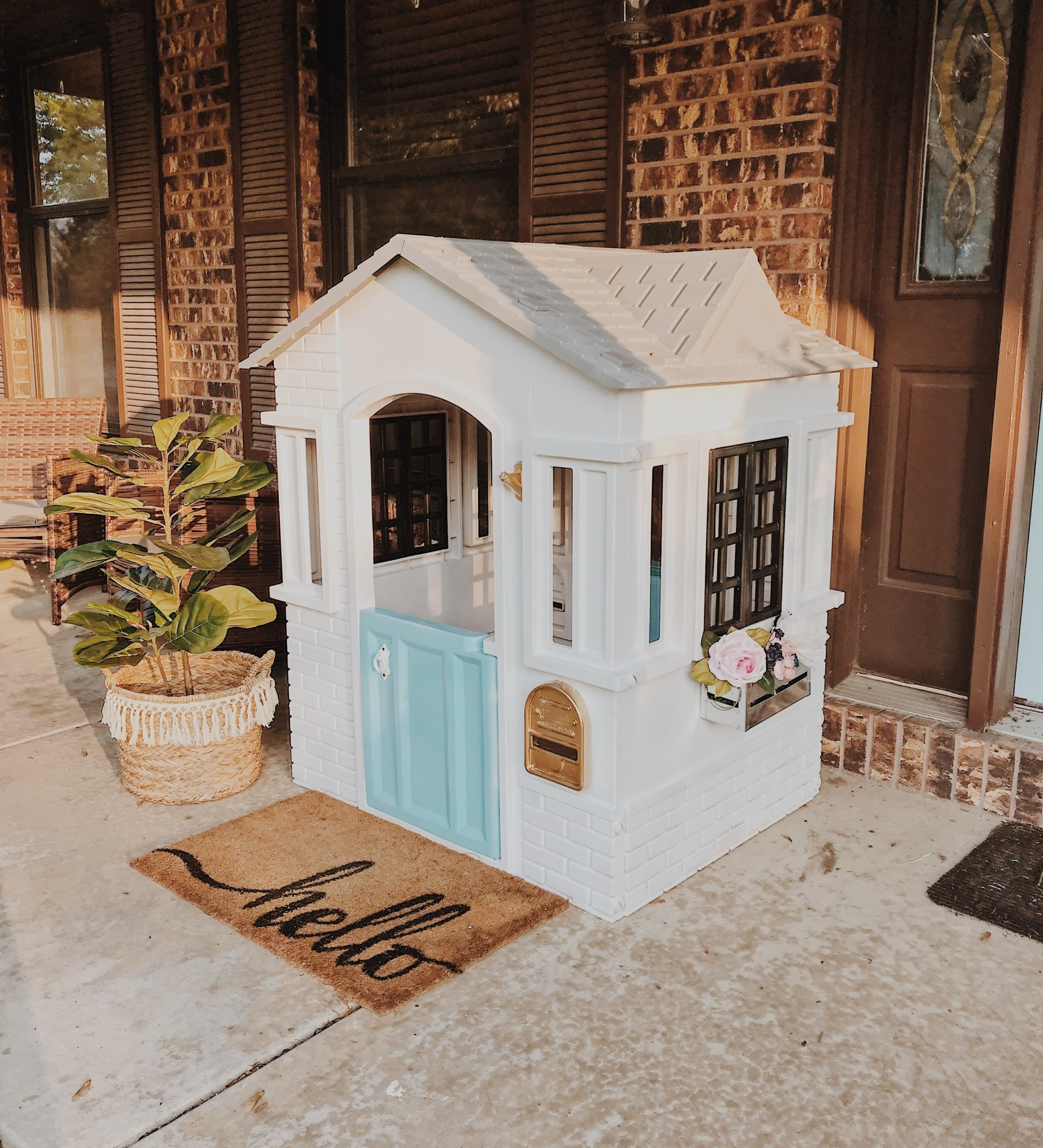 Cutest little modern farmhouse cottage! SO EASY to recreate this look- snag the simple how to and makeover your own plastic playhouse... no more yard eyesores! #diy #modernfarmhouse #playhousemakeover #littletikes