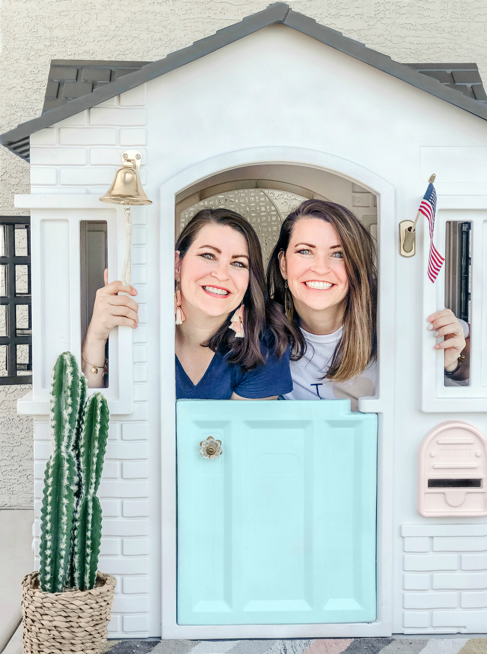 Twin sister DIYers LollyJane.com Kristi + Kelli transformed this plastic playhouse in no time at all-- click to see the before and how-to! Amazing! #diy #playhousemakeover