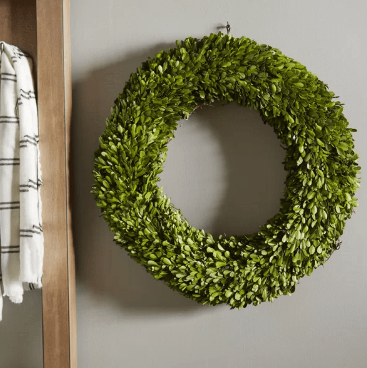 This preserved boxwood wreath is a staple in any farmhouse! #farmhouseideas #farmhousedecor #farmhousewreath #farmhous