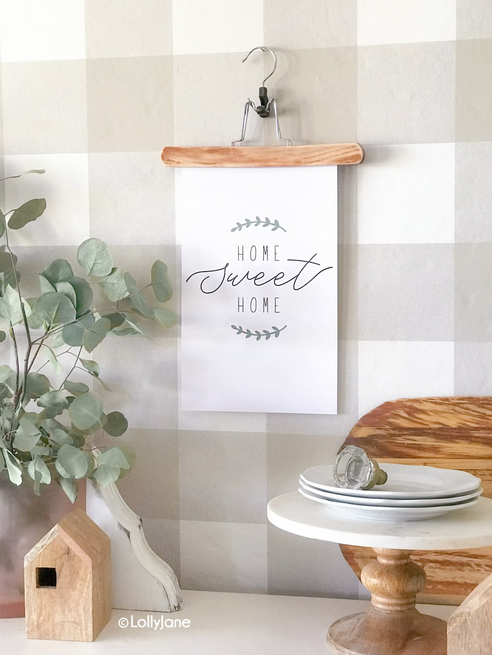 "Jump on the farmhouse trend without spending an arm and a leg! Simply print this pretty ""Home Sweet Home"" printable art to add just enough farmhouse charm! #farmhouse #printable #freeprintable #printableart #farmhouseart #farmhouseprintable"