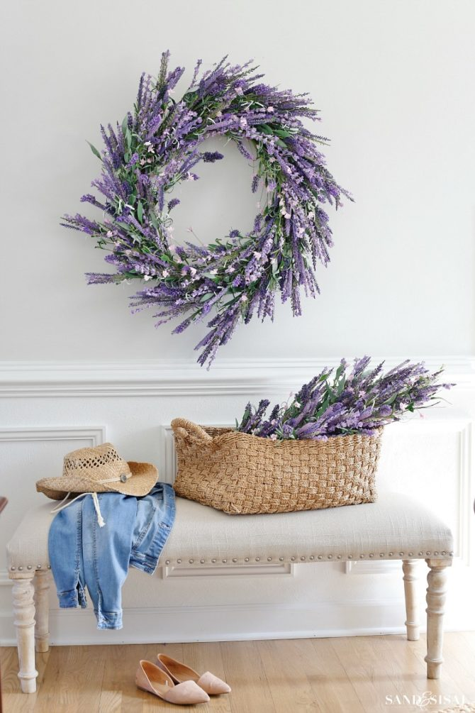 Adore these faux lavender decorating ideas, just place the in a slouchy basket and hang a lavender wreath, so easy and so pretty! #lavenderdecor #lavenderwreath #fauxlavender #decoratingideas #decoratingwithlavender