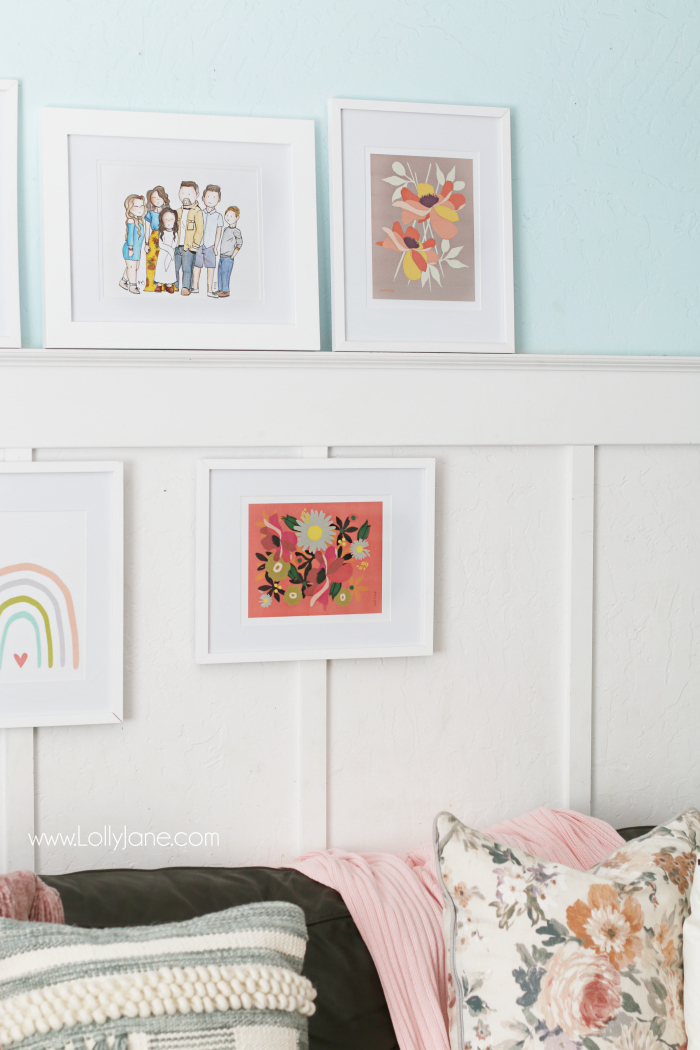 Gallery wall family room floral prints. Love this eclectic gallery wall featuring pink decor, floral prints and a watercolor rainbow print. #floraldecor #gallerywall #familyroomwalldecor #walldecorations #gallerywallideas
