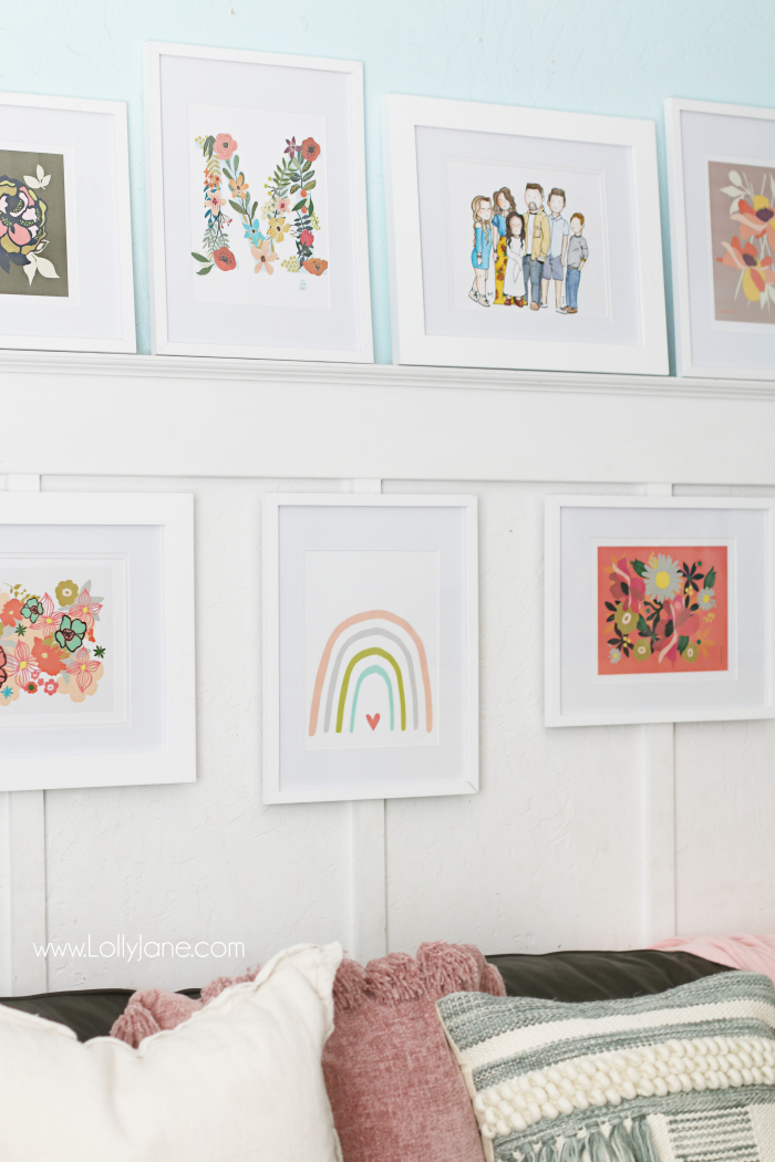Loving these white gallery wall frames with white mats to create a uniform gallery wall and colorful prints. Floral prints with a watercolor rainbow print make for a fun boho gallery wall. #bohodecor #gallerywall #galleryframes #whiteframes #walldecor
