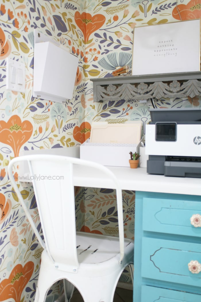 How to create a girl boss small home office, turn a boring beige space into the office of your dreams! This home office is fun, bright and super organized. #trendyoffice #officedecor #girlboss #officewallpaper