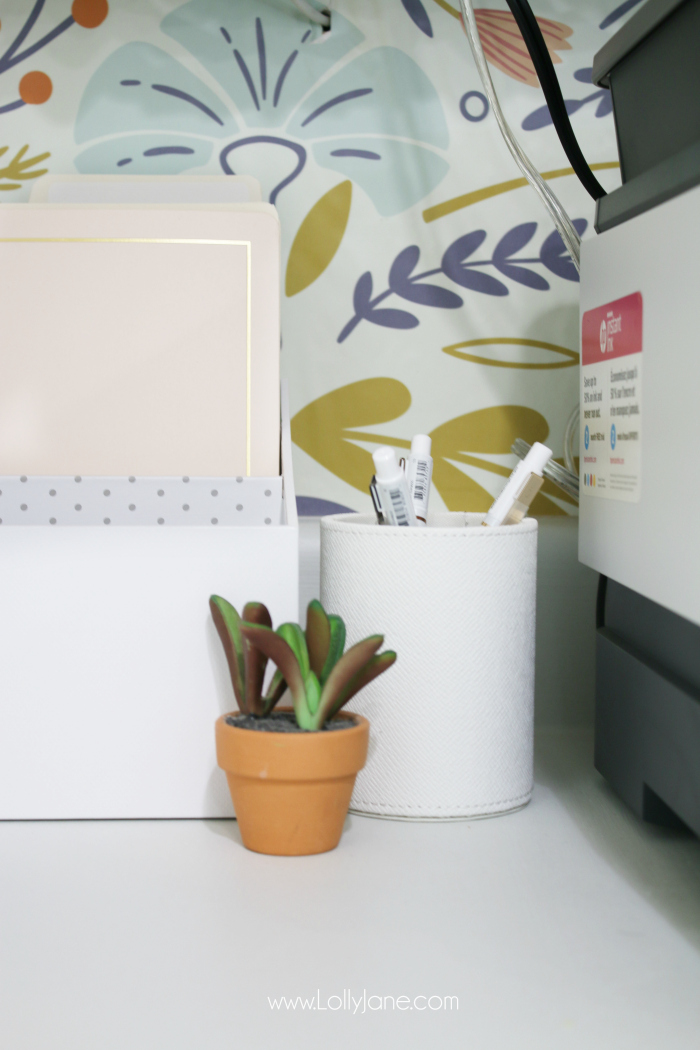 How to create a girlboss office space using a fun removable wallpaper and white office accessories, so cute! #officedecor #officespace #smalloffice #girlboss #girlbossoffice #smallbusiness