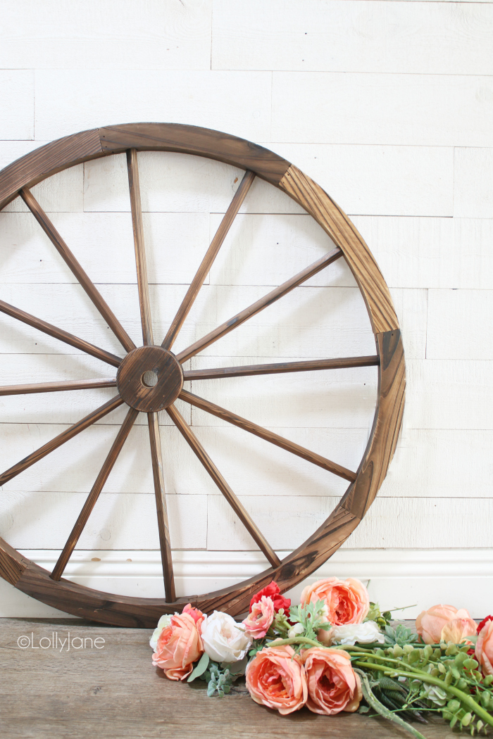 All the simple supplies to make a wagon wheel wreath. Easy to make summer wreath decoration, so fun! #wagonwheelwreath #diywreath #summerdecorations #summerdecor #howto