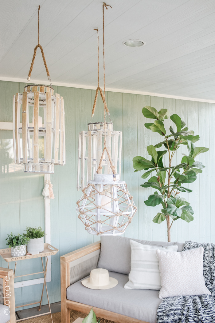 Group a trio of lanterns to pull a coastal vibe and cozy up an outdoor space! Love this farmhouse porch! #farmhousestyle #farmhouse #coastalstyle #driftwood #patio