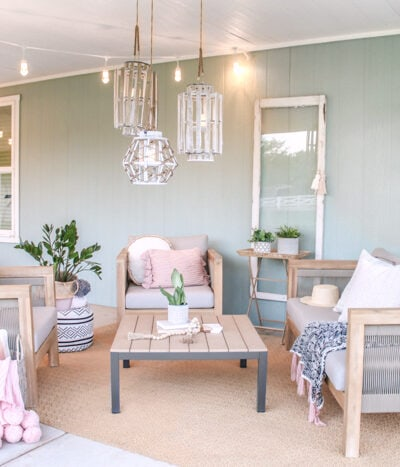 Loving this cozy coastal farmhouse outdoor space! Read through to see how to cozy up your own outdoor living areas! #coastal #coastalstyle #farmhouse #patio #porch #summertime