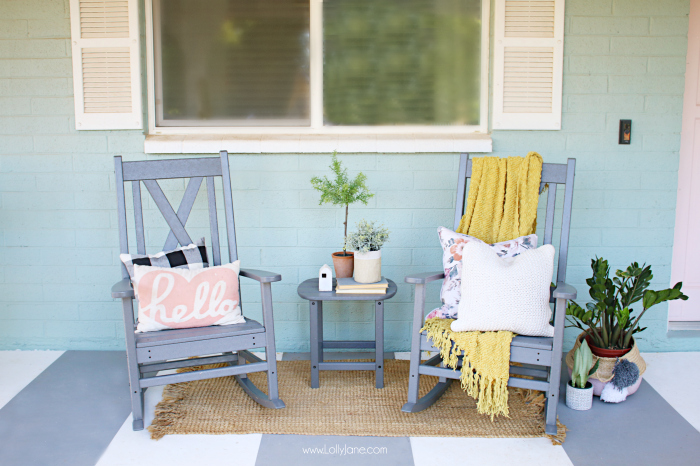 White shutters and companion rocking chairs serve up a generous helping of farmhouse hospitality. The clean spare space on this front porch lends a simple, friendly, and natural elegance to its rural home. #farmhousedecor #rockingchairs #grayrockingchairs #porchdecorations #farmhousedecor