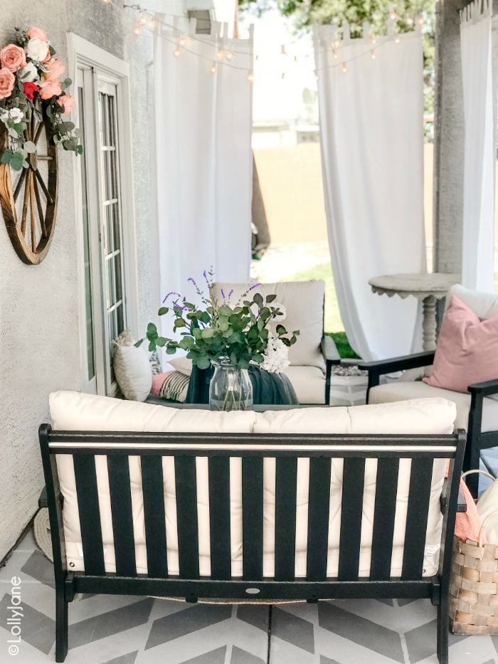 Looking for small farmhouse porch decorating ideas? You'll love this painted concrete porch with its cozy modern farmhouse furniture and round jute rug. #roundrug #farmhouserug #stencilconcrete #farmhousedecor #modernfarmhouse #outdoordecor #porchdecor #polywood