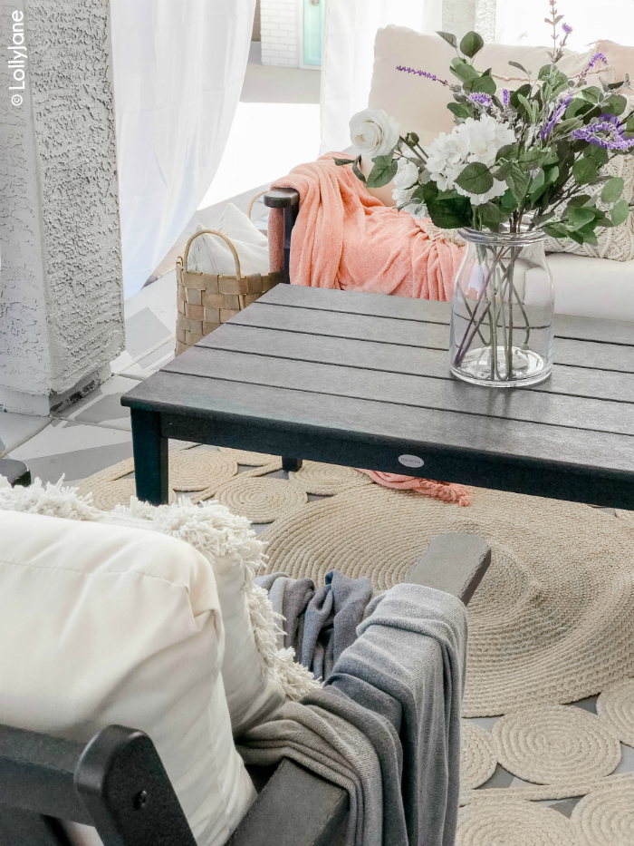Are you looking for small patio decorating ideas? Check out our modern farmhouse porch, full of cozy accents and durable furniture. #polywood #farmhouseporch #porchdecor #farmhousedecorations #modernfarmhouse #cozyporch