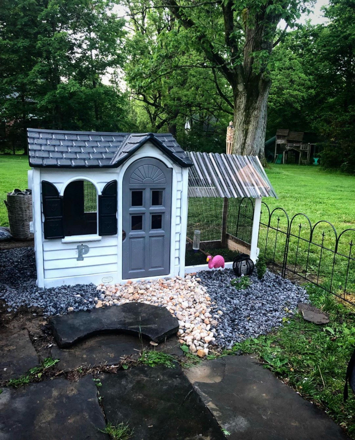 Need a playhouse that is animal friendly? #woodenplayhousemakeover #diyplayhousemakeover #costcoplayhousehack #playhousehack