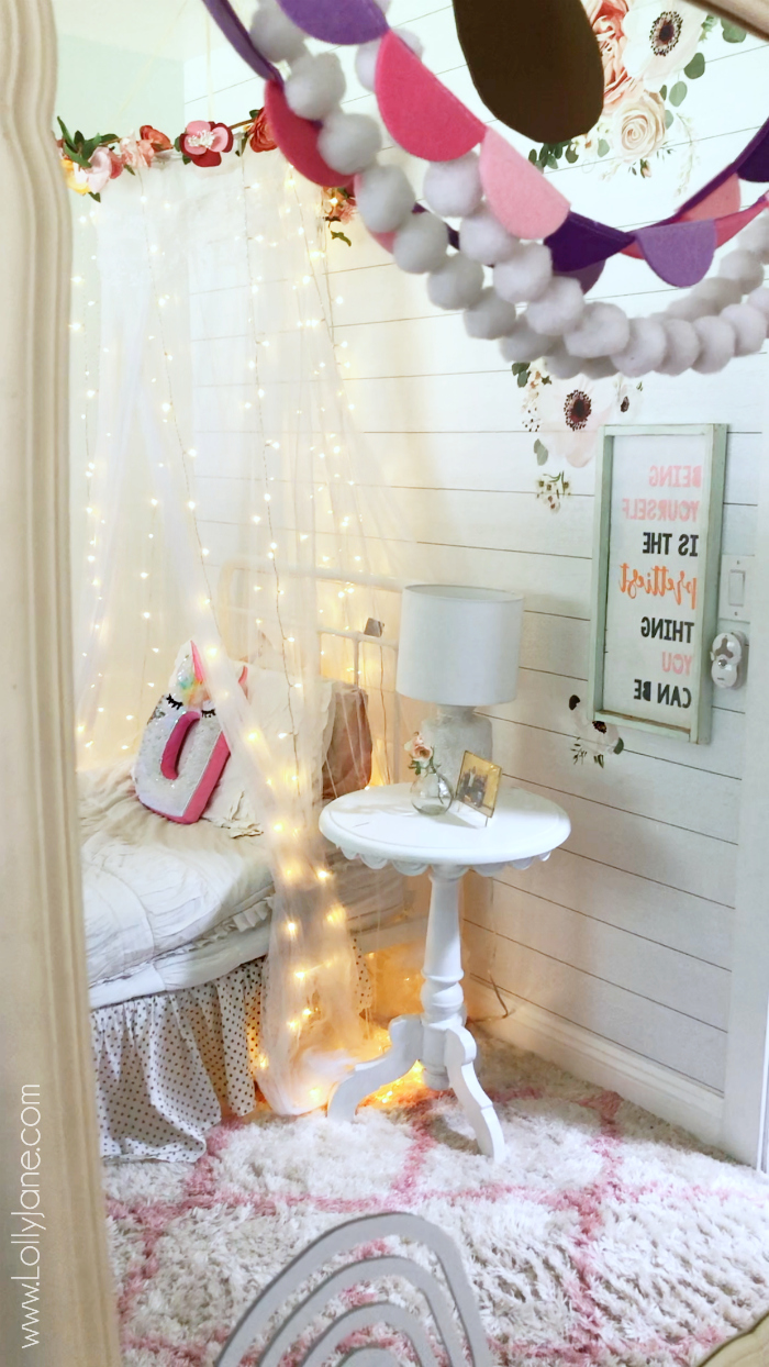 Easy to make floral bed canopy, the cutest accessory for a little girls room! #homedecor #mosquitonet #tulletent #floralcanopy #bedcanopy #diybedcanopy
