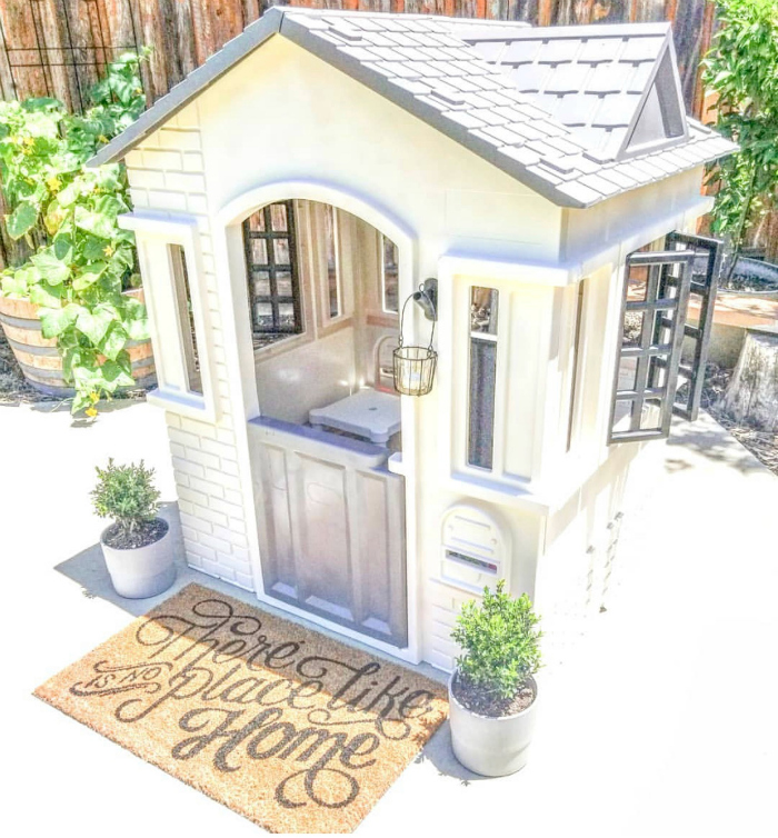 Check out this white and grey playhouse!! #whiteplayhouseremodel #remodelplayhouse #woodenplayhousemakeover #cuteplayhousemakeover #diyplayhouse