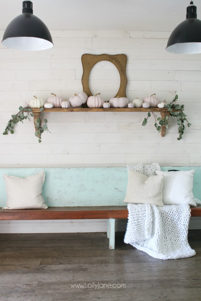 Dying over this simply fall mantel decor! Love the blush pink painted pumpkins with pretty natural leaves. #falldecor #blushpinkpumpkins #pumpkindecor #pinkpumpkins #fallmanteldecor #fall2019