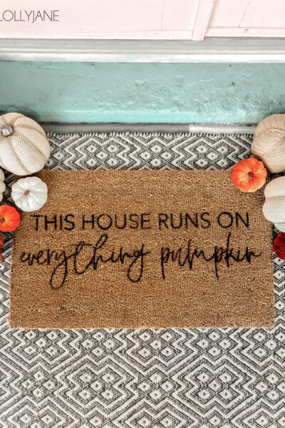 Love the trendy fall rugs? Make your own with a little paint + a stencil, so cute!! #diyfallwreath #fallwreath #diy #falldecorations #diyrug #fallrug