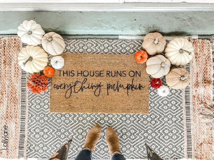 Love the trendy fall rugs? Make your own with a little paint + a stencil, so cute!! #diyfallwreath #fallwreath #diy #falldecorations #diyrug #fallrug