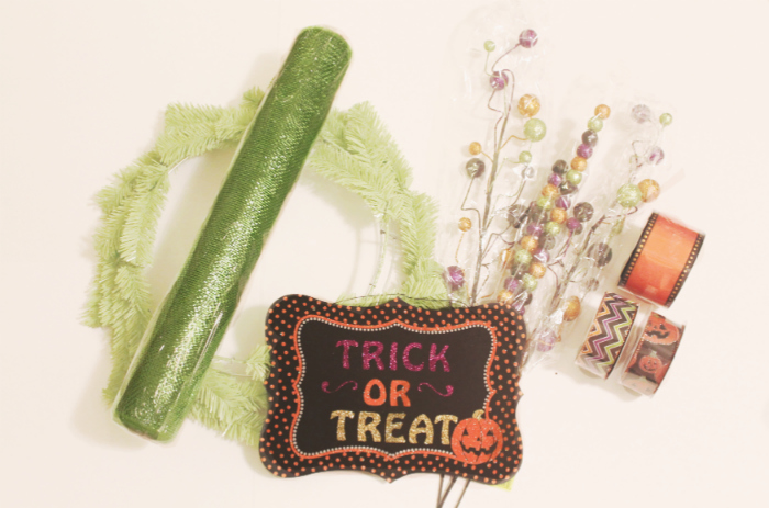 Supplies to make a mesh Halloween wreath. You've got to see how cute this Halloween wreath turned out! #halloweenwreath #decomesh #decomeshwreath #decoemeshwreathideas #halloweenwreath #diyhalloweenwreath