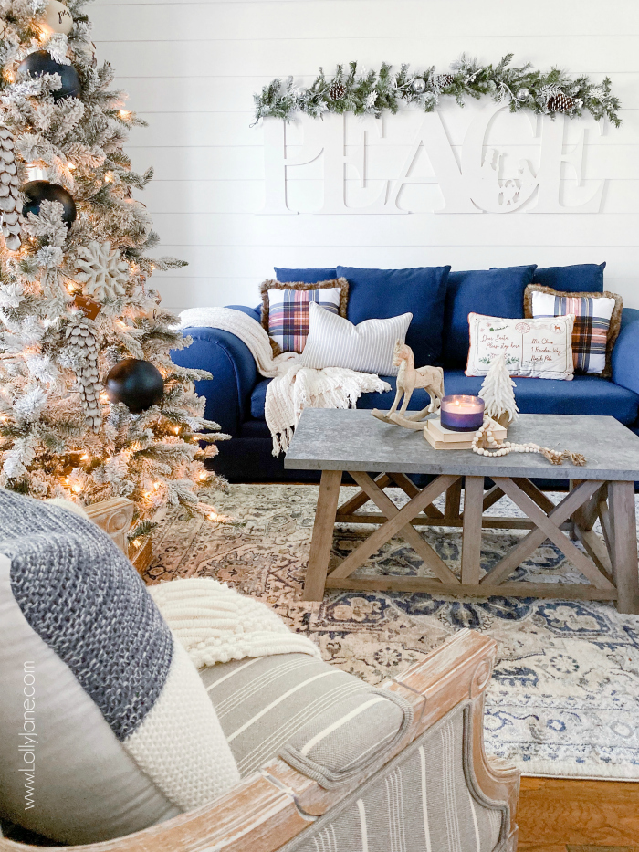 Looking for ways to cozy your living room for Christmas? We have lots of affordable tips to create a stunning farmhouse Christmas living room! #farmhousechristmas #cozychristmas #christmaslivingroom #livingroomideas #christmaslivingroomideas #howtodecoratefarmhousechristmas