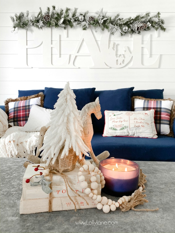 Learn how to make these DIY stamped books with few supplies! Such a fun handmade gift idea! Pretty farmhouse Christmas living room with easy to make accents! #diystampedbooks #stampedbooks #handmadegift #diygift #handmadegiftideas #diygiftideas #diystampedbooks