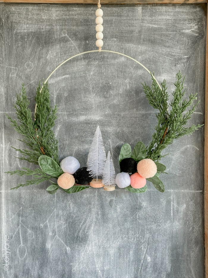 Loving this EASY to make holiday wreath... perfect for winter or Christmas. And SO affordable to copyat! #diy #christmasdecor #christmasdecorations #Christmaswreath #ChristmasDIY