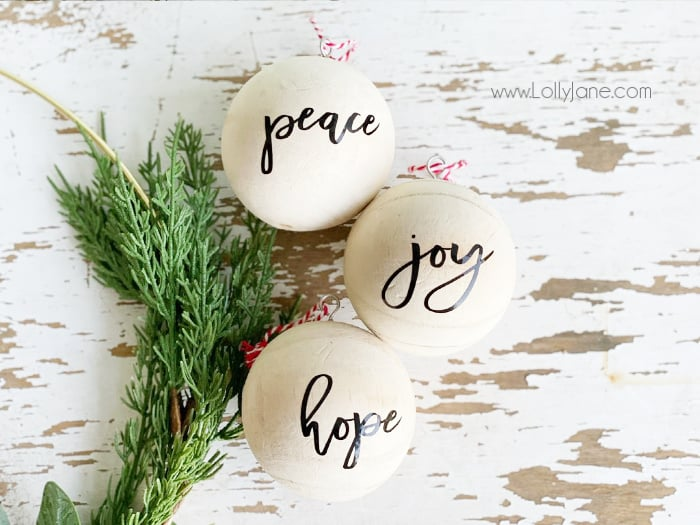 Make your own gorgeous script wood ball ornament set for your Christmas tree. This simple DIY is the perfect craft to get you in the Christmas spirit. #hadmadeChristmas #diyornament #diychristmas #christmasornament #christmasdecor