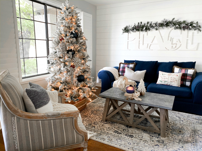 Farmhouse Christmas living room ideas to cozy up your holiday season! Love this warm and inviting Christmas decor using lots of whites and neutrals! #farmhousechristmas #whitechristmasdecor #neutralChristmasdecor