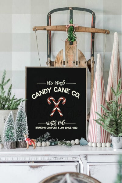 """FREE Christmas Art, so cute!! Just print and display this darling """"Kris Kringle Candy Cane Co."""" on your mantel, use as a card, or making into a bunting! #freeprintable #christmasdecor #christmasdecoration #candycane #christmasart #christmasprintable"""