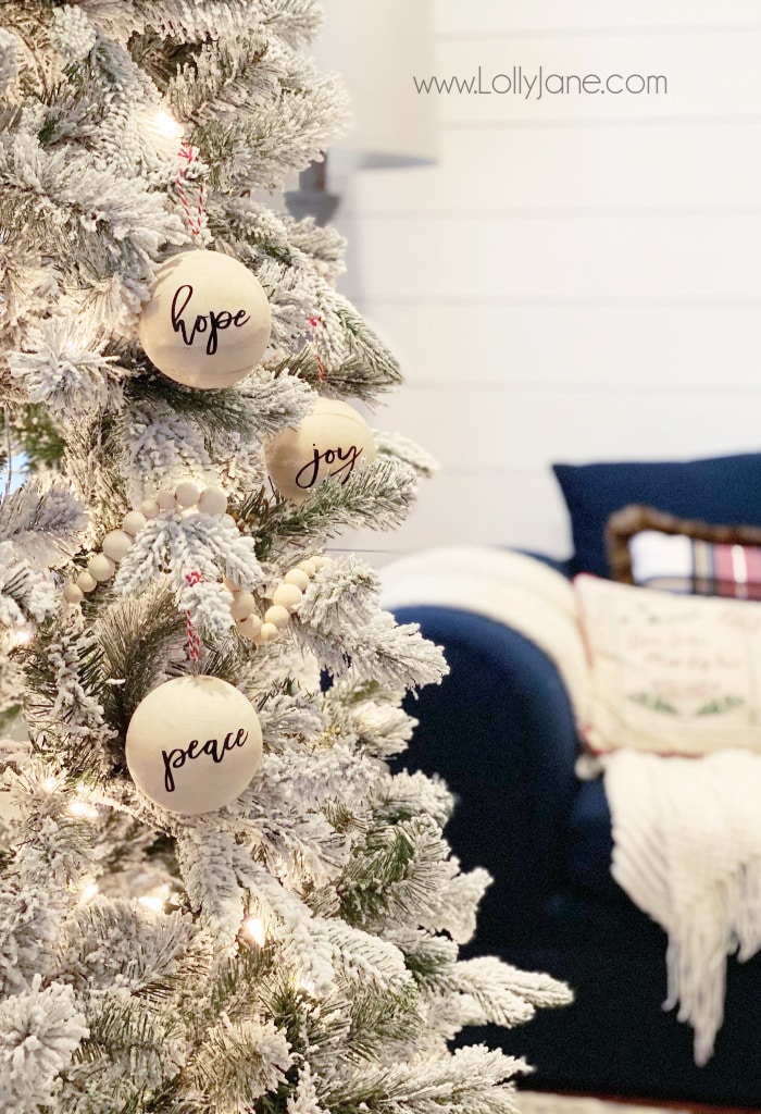 DIY Script Wood Ball Ornament | Add a pretty script sticker to these unfinished wood ornaments to create custom ornaments on the cheap! Such a fun easy to make Christmas craft! #handmadeornament #scriptwoodvballornament #woodballornament #sphereornament #diychristmas