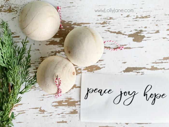 Check out these few supplies to make these easy script wood ball ornaments. Do you love handmade Christmas ornaments too? Check out this quick neutral Christmas tree decor! #farmhousechristmas #diyornament #handmadeornament #handmadeChristmas #easyChristmasdecor