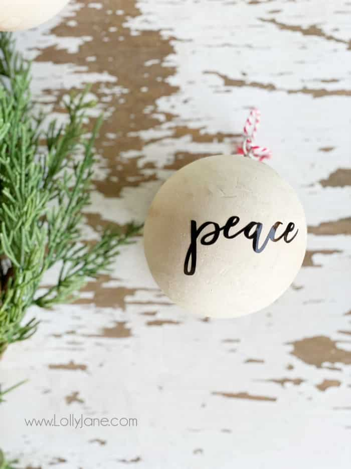 Easy wooden ball Christmas ornament DIY! Such a simple ornament to decorate a neutral tree or gift to a friend for the holidays. #diyornament #handmadeornament #farmhousechristmas #neutralchristmasdecor