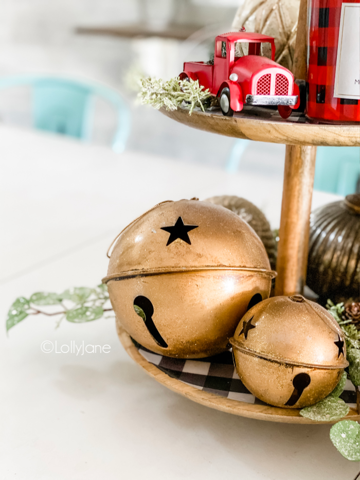 How to transition Christmas to winter decor with a tiered tray. Use neutral and gold farmhouse decor for Christmas then swap the red accents for white! So easy to recreate this pretty holiday tiered tray centerpiece. #tieredtray #holidaytieredtray #christmastieredtray #easychristmasdecor
