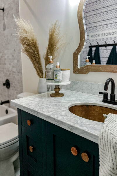 Small Modern Farmhouse Bathroom, so pretty! See how we made every inch of this space practical! #modernfarmhouse #modernfarmhousebathroom #marbletile #subwaytile